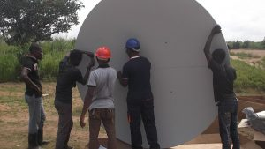 Mounting the VSAT antenna with the locally hired technicians